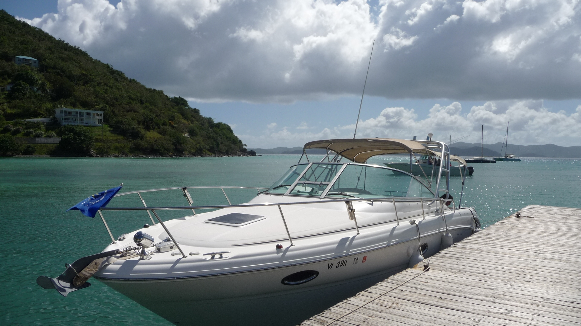 Our 31' SeaRay power-cruiser with luxury cabin and extended swim platform is ideal for exploring our pristine waters and majestic islands